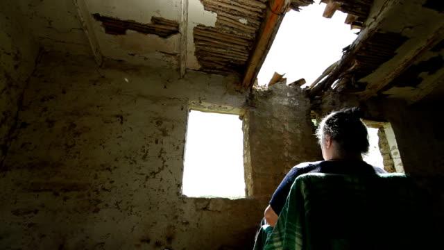 Senior Woman Looking Through Window video