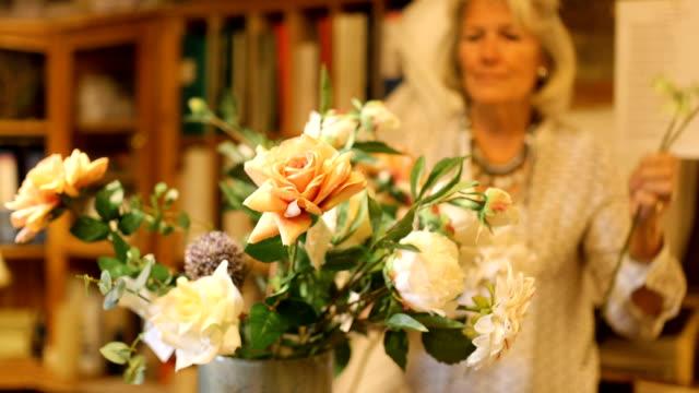 Senior Woman Making Bouquet of Flowers video