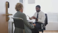 istock Senior Woman Meeting With Male Financial Advisor In Office 1153545858