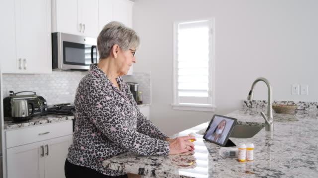 Senior Woman on a Virtual Doctor Visit - video