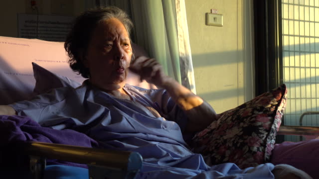 senior woman patient coughing video