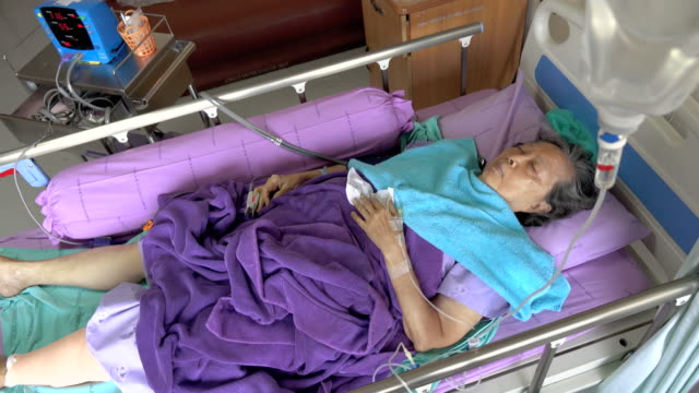 Senior woman patient in hospital bed video