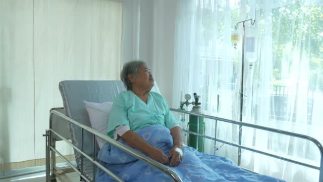 senior woman patient  sit on bed , feel depressed video
