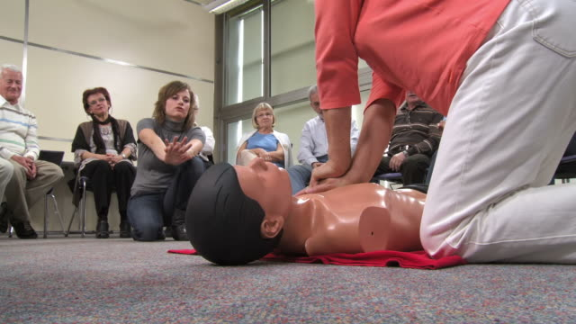 HD: Senior Woman Practicing Chest Compressions video