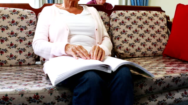 Senior woman reading book in braille video