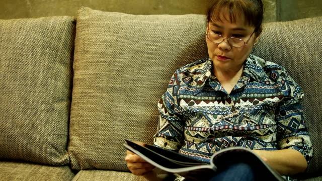 Senior woman reading book video