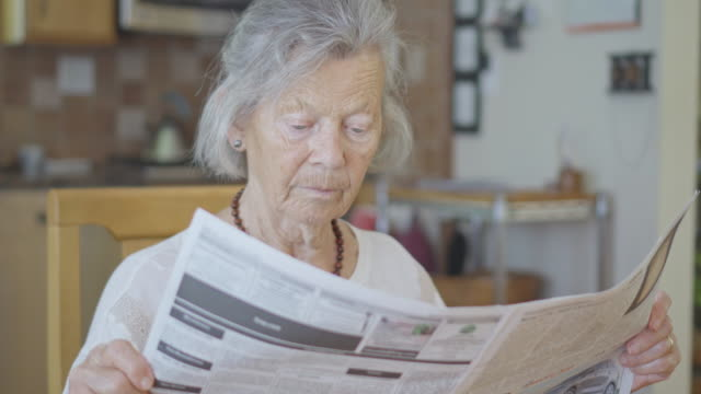 Senior Woman Reading the Newspaper video