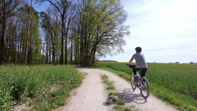 Senior Woman Riding Electric Mountain Bike – Video