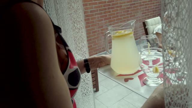Senior Woman Serving Lemonade