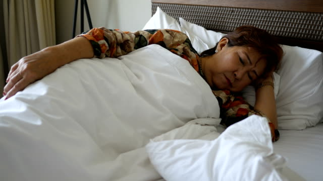 Senior woman sleeping video