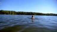istock Senior Woman Swimming in Lake 1277354336