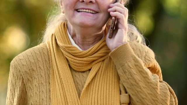 Senior woman talking on cell phone, favorable tariffs for elderly, roaming