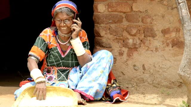 Senior woman talking on mobile phone video