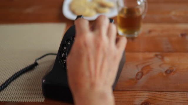 Senior woman talking on telephone at home.