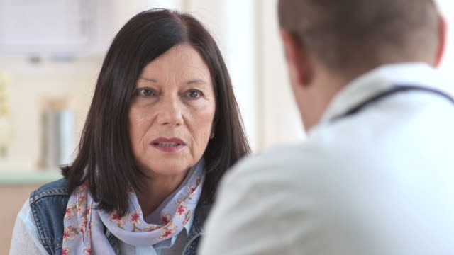 HD: Senior Woman Talking To Doctor HD1080p: Close-Up shot of a worried senior woman talking with doctor in a doctor's office. hd format stock videos & royalty-free footage