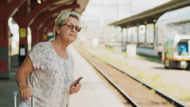 en senior kvinna som reser med tåg - waiting for a train sweden bildbanksvideor och videomaterial från bakom kulisserna