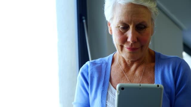 Senior woman using digital tablet 4k video