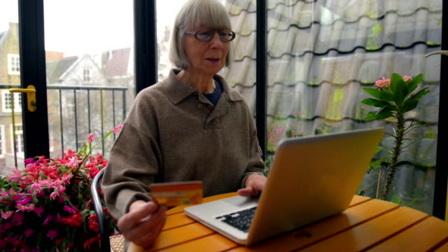 Senior woman using internet video