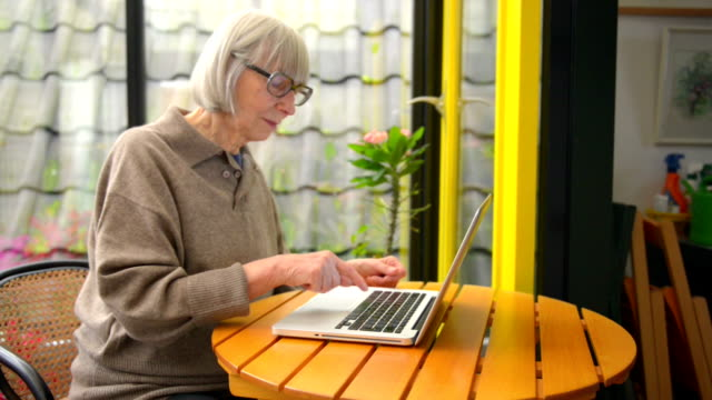 Senior woman using laptop video
