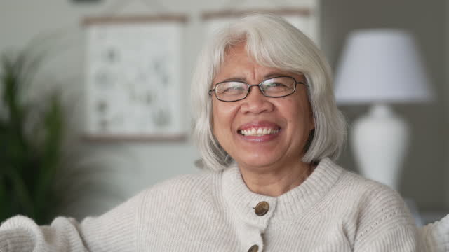 Senior woman A senior woman is smiling and looking towards camera filipino ethnicity stock videos & royalty-free footage