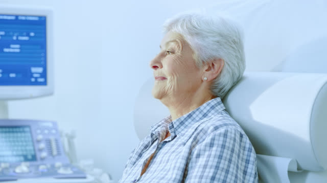 Senior woman waiting to be examined by the nurse video