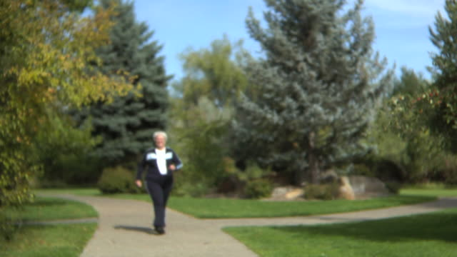 Senior woman walking at a park video