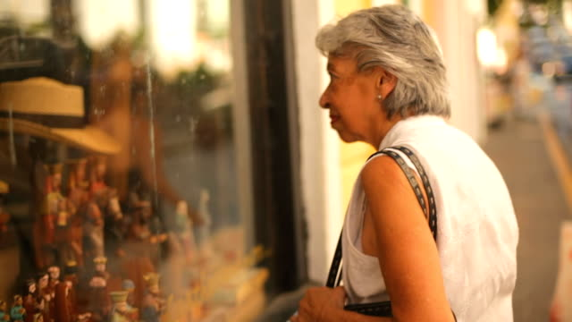 senior woman window shops - baby boomer stock videos and b-roll footage