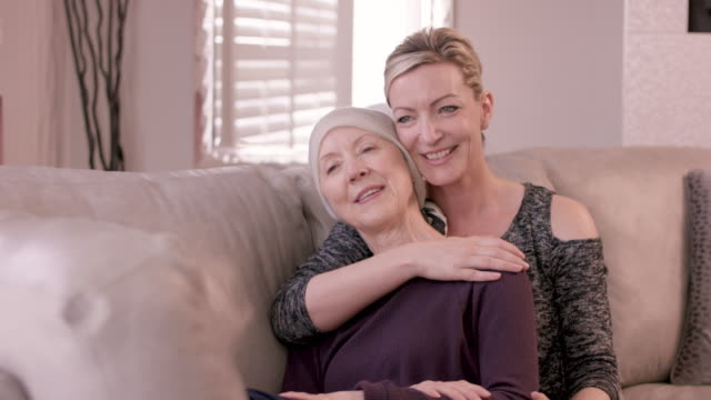 Senior Woman With Cancer Being Embraced By Adult Sister video