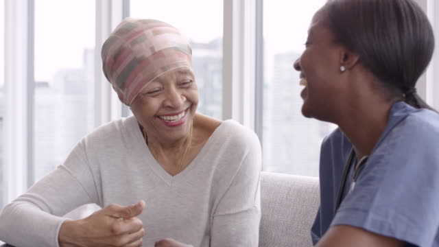 Video Senior woman with cancer reviews test results with female doctor