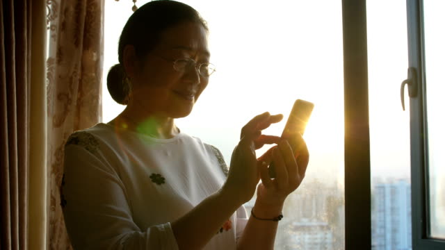 Senior woman with mobile phone Happy life with mobile phone east asian ethnicity stock videos & royalty-free footage