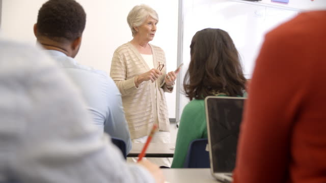 Senior woman with tablet teaching adult education class Senior woman with tablet teaching adult education class adult education stock videos & royalty-free footage
