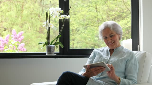 Senior woman with tablet video