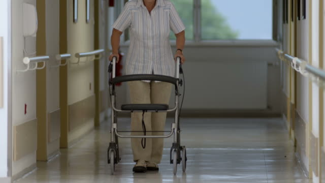 hd: senior woman with wheeled walker - elderly care bildbanksvideor och videomaterial från bakom kulisserna