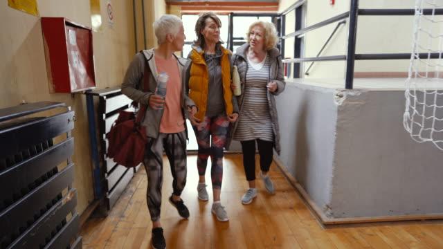 Senior women arriving at dance class Senior women arriving at dance class baby boomers stock videos & royalty-free footage