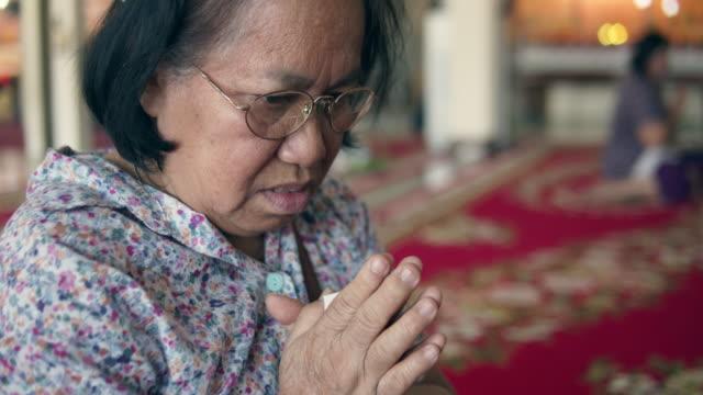 Senior women asking God For Help