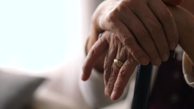 Senior women holds hands on walking stick Senior women holds hands on walking stick orthopedic equipment stock videos & royalty-free footage