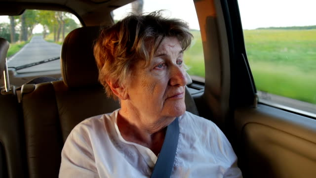 Senior women in the car at sunset video
