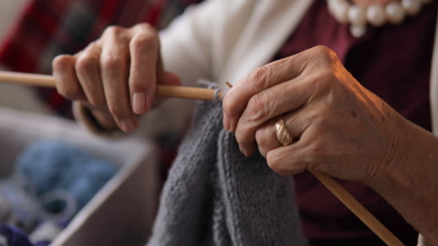 senior women knitting at home - cucitura video stock e b–roll