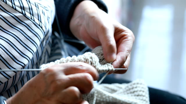 Senior women knitting video
