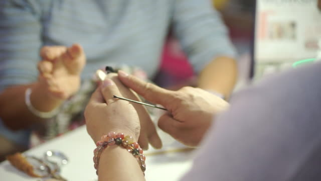 senior women sewing craft product in the workshop, handmade and handicraft concept. - sarta video stock e b–roll