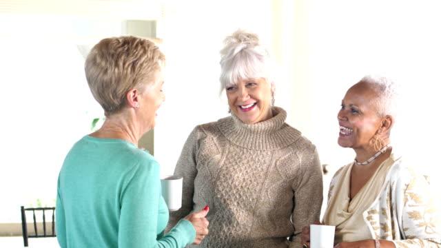 Senior women smiling, conversing video
