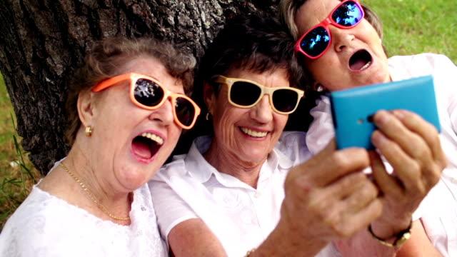 Senior women taking a selfie Senior women taking a selfie grandmother stock videos & royalty-free footage