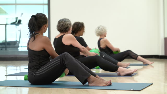 Senior women using medicine balls video