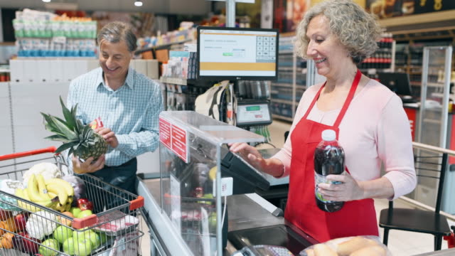 Seniors at Supermarket Checkout Seniors at Supermarket Checkout register stock videos & royalty-free footage