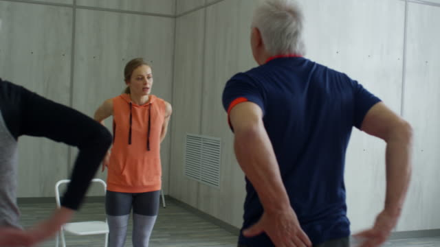 Seniors Body Tapping With Yoga Instructor Stock Video Download Video Clip Now Istock