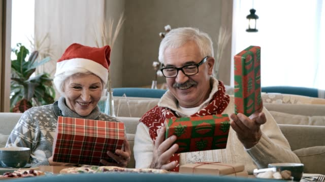 Seniors Celebrating Christmas in Restaurant and Sharing Gifts video