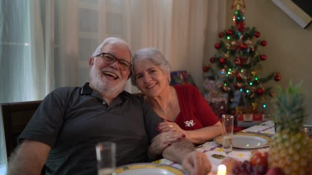 Seniors Celebrating Christmas Time at Home Portrait - video
