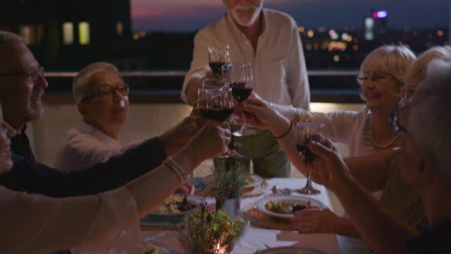 Seniors Having Dinner On Rooftop