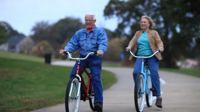 Seniors on Bikes in Park video