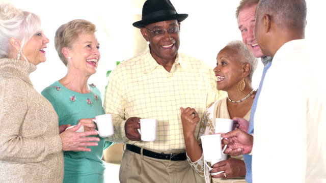 Seniors socializing, talking over coffee video